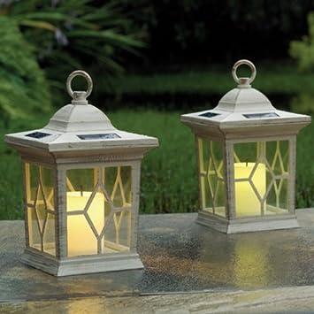 83e9b4bc98ae Set de 2 faroles solares para jardín, con velas parpadeantes: Amazon.es:  Jardín