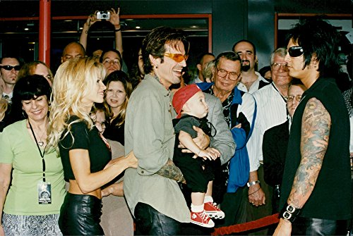 Vintage photo of Pamela Anderson and Tommy Lee, together with his son Brandon (Pamela Anderson Costumes)