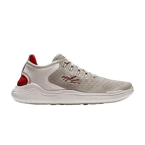 25a7db2a0a87 Amazon.com  Nike Women s Free RN 2018 IWD Running Shoe (7.5 B(M) US ...