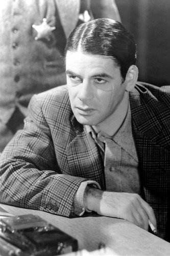 (Paul Muni in Scarface holding cigarette sitting looking disgusted 11x17 Mini Poster)