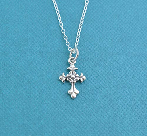 Little Girl's Scrolled Cross necklace in sterling silver on a 14