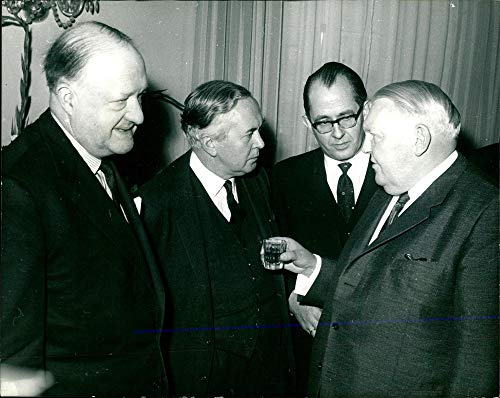 Vintage photo of Dr. Erhard with Mr. Wilson and Mr. Butler.