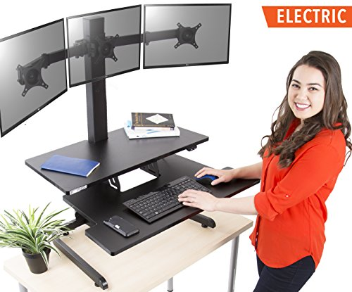 Techtonic Electric Monitor Arm Standing Desk by Stand Steady | Large Spacious Stand Up Desk | Easy Sit to Stand with the Push of a Button - Quiet! | 3 Levels to Maximize your Space! (3 Monitor Mount)