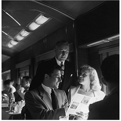 Marilyn Monroe with Others Looking at Paper on Train 8 x 10 Inch Photo