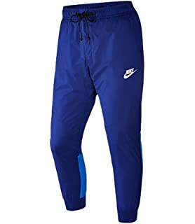 1a21959904379 Amazon.com : Nike Men's Windrunner Cuffed Track Pants Running White ...