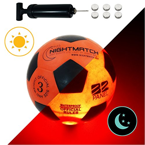 NightMatch Light Up Soccer Ball Kids Edition INCL. BALL PUMP and SPARE BATTERIES - Inside LED lights up when kicked - Glow in the Dark Soccer Ball - Youth Size 3 - Official Size & Weight -orange/black -