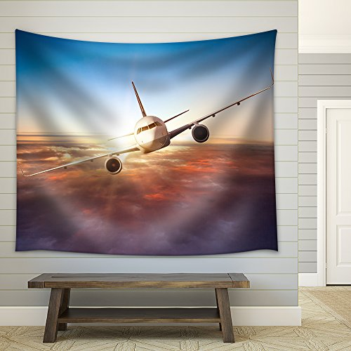 wall26 - Commercial airplane flying above clouds in dramatic sunset light - Fabric Wall Tapestry Home Decor - 68x80 inches by wall26