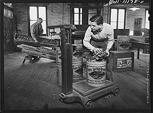 1942 Photo Lititz, Pennsylvania. Lititz Springs Pretzel Company, owned by Lewis C. Haines (background) who is unloading a tray of pretzels which has come up on a dumb waiter from the baking room below
