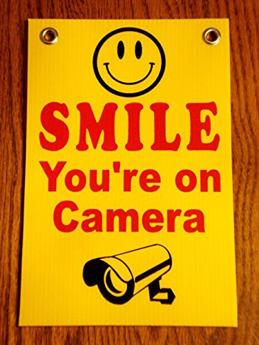 grommets-security-surveillance-smile-youre-on-camera-sign-size-8x12-printed-1-side