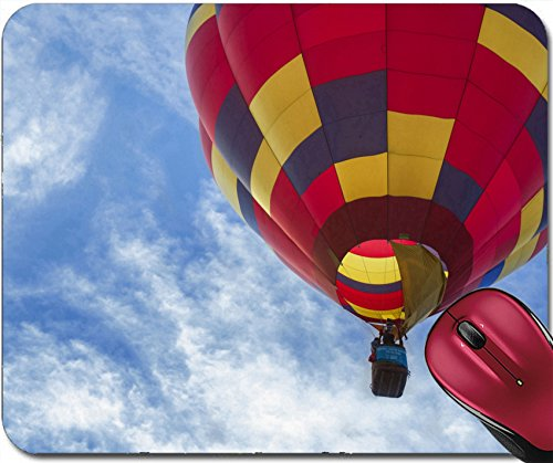 Liili Mousepad IMAGE ID 31897792 One colorful red blue and yellow hot air balloon rising against a bright blue sky with whispy (Whi Under Cabinet)