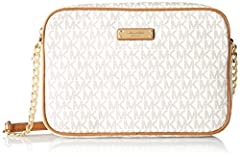 A Michael Kors Jet Set Large Crossbody Bag is crafted in signature logo-print PVC with gold-tone hardware, leather trim, and a fully lined interior. This Michael Kors crossbody features a main zip pocket, interior wall pockets and an adjustab...