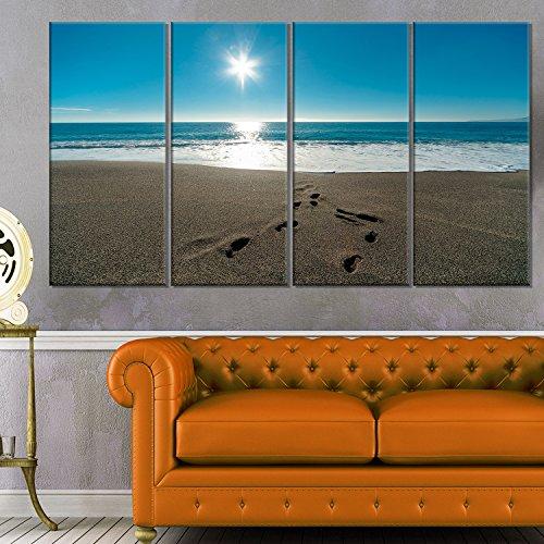 Designart Blue Sea and Footprints in Sand Large Seascape Art Canvas Print, Blue