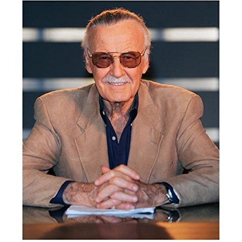 Stan Lee 8 Inch x10 Inch Photo Writer Producer Actor Iron Man Spider-Man Seated Wearing Tan Jacket Over Navy Blue Shirt Pose 2 -