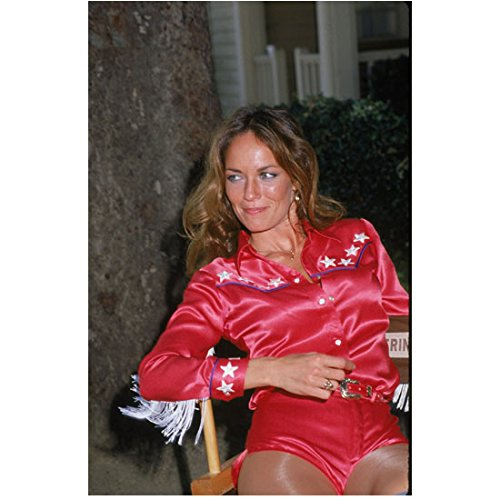 Catherine Bach 8 inch x 10 inch Photo The Dukes of Hazzard Thunderbolf and Lightfoot African Skies Seated in Red/White Shorts Outfit Pose 2 -