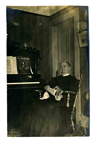 Woman in Rocking Chair In Front of Piano with Sheet Music Real Photo Postcard -