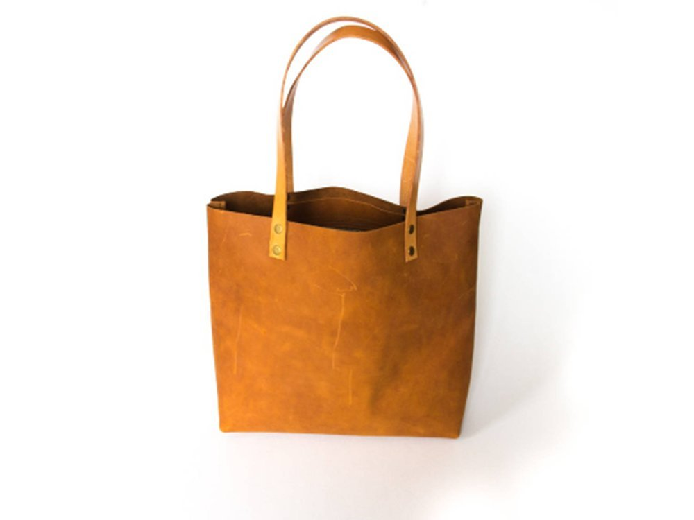Large distressed genuine leather tote with inside pocket and key holder. Cognac genuine crazy leather tote made with premium leather