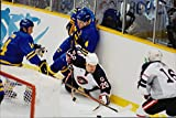 Vintage photo of Ice hockey player fighting for the puck during the ice hockey match Sweden - USA during the Winter Olympics in Nagano 1998