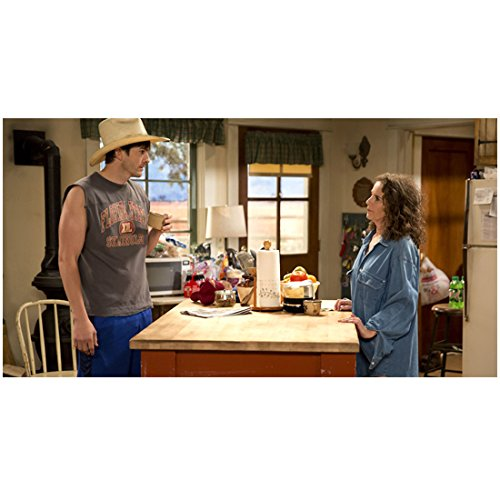 The Ranch (TV Series 2016 - ) 8 inch by 10 inch PHOTOGRAPH Ashton Kutcher from Thighs Up Holding Cup Standing Across Counter w/Debra Winger kn ()