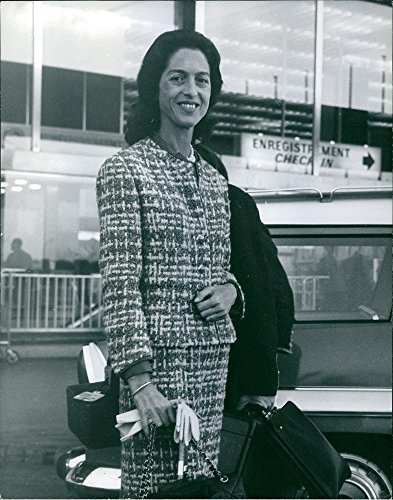 Vintage photo of Queen Alexandra of Yugoslavia striking a photo at the airport, 1963.