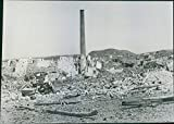 Vintage photo of Smokestack survives Pantelleria Bombing.A high smokestack stands alone amid ruins caused by Allied bombers on the fortress of Pantelleria Island in the Mediterranean. Pantelleria military garrison gave up after undergoing continuous bombardment by air and sea.
