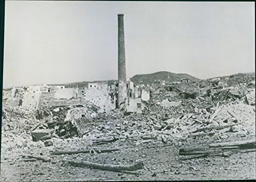 (Vintage photo of Smokestack survives Pantelleria Bombing.A high smokestack stands alone amid ruins caused by Allied bombers on the fortress of Pantelleria Island in the Mediterranean. Pantelleria military garrison gave up after undergoing continuous bombardment by air and sea.)