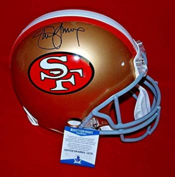 d436c1bb93e Amazon.com  Steve Young Signed Helmet - full size Beckett GTSM holo COA 2 -  GTSM Certified - Autographed NFL Helmets  Sports Collectibles