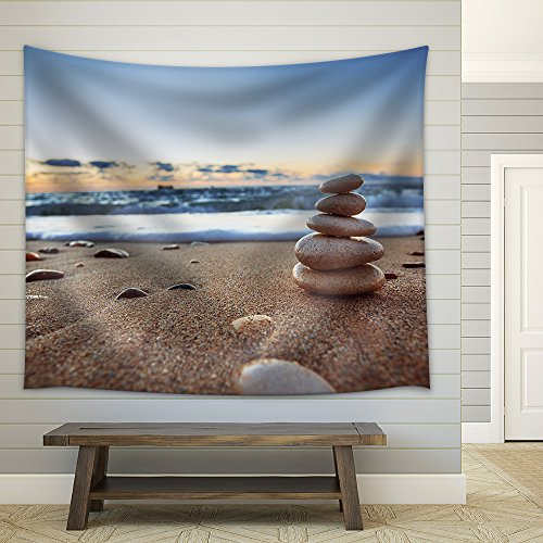 Stones balance on beach sunrise shot Fabric Wall