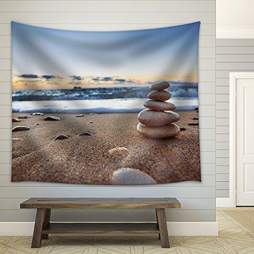 Stones balance on beach sunrise shot Fabric Wall Tapestry