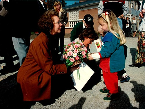Vintage photo of Princess Christina receives a flower bouquet from a little girl at the inauguration of Ronald McDonald's house at Huddinge Hospital