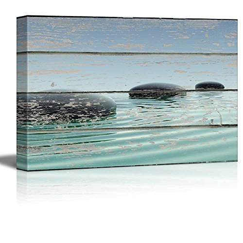 Zen Stones in Water on Vintage Wood Textured Background Rustic Country Style