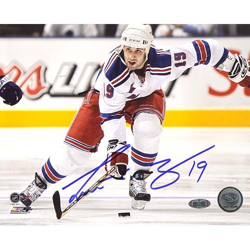 (NHL Scott Gomez Carrying Puck up Ice Autographed 8-by-10-Inch Photograph)