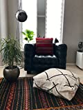 White and black Moroccan Kilim pouf made from vintage rugs.