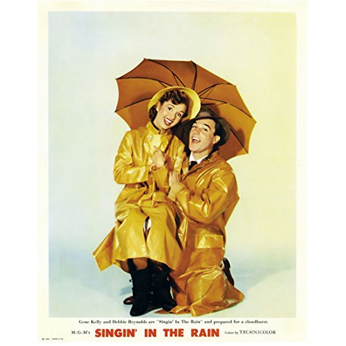 Debbie Reynolds 8 Inch x 10 Inch PHOTOGRAPH Singin' in the Rain Fear and Loathing in Las Vegas Charlotte's Web in Yellow Rain Gear w/Gene Kelly kn (Fear And Loathing In Las Vegas Pics)
