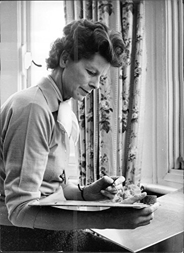 Vintage photo of Mrs. Anthony Greenwood painting on paper.