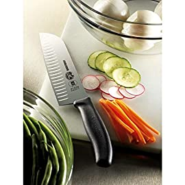 Victorinox Fibrox 7-Inch Granton Edge Santoku Knife 20 VERSATILE KITCHEN ESSENTIAL. Slicing, dicing, mincing -- this knife can do it all. This Santoku knife's combines the features of a cleaver and a chef's knife with a unique shape that allows it to be used as a spatula to scoop up whatever you are chopping. GRANTON EDGE. Featuring a Granton edge that prevents food from sticking to the blade and minimizes friction. The flat cutting edge doesn't rock, creating a highly efficient chopping motion and is ground in two directions to create long-lasting sharpness. EASY HANDLING. This knife features an ergonomic Fibrox Pro handle for a non-slip grip -- even when wet. This exceptional knife is weighted and balanced for easy handling and comfort.