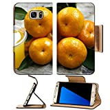 organ juice - MSD Premium Samsung Galaxy S7 Edge Flip Pu Leather Wallet Case cup of fresh orange juice and oranges on a vintage wooden IMAGE 24428469