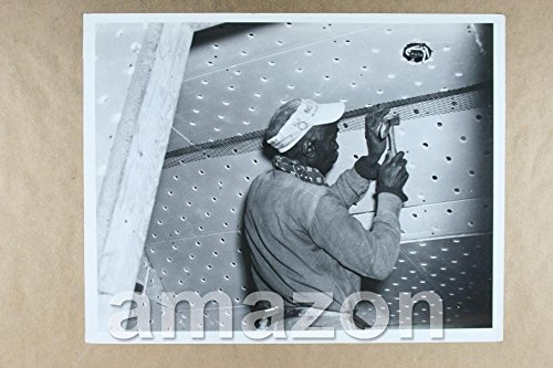 vintage-photo-of-repair-man-working-on-ceiling-of-building-qn112