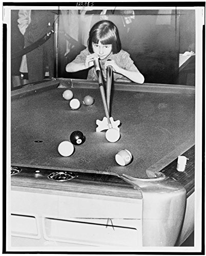 1966 Photo Jean Balukas lines one up in Grand Central Station / World Telegram & Sun photo by John Bottega. Jean Balukas, age six, playing pool in Grand Central Station. - In Store Station Coupon Watch