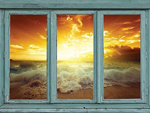 Golden sunset through the clouds as waves crash onto a tropical beach Wall Mural