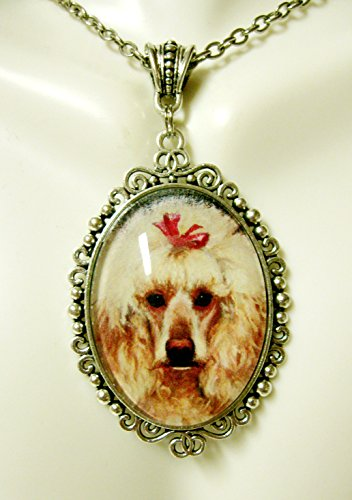 Blond poodle with a red bow pendant with chain - DAP09-642