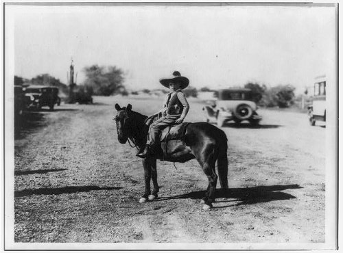 Photo: Stanton Armour,boy,seated on horse,wearing 5 gallon -