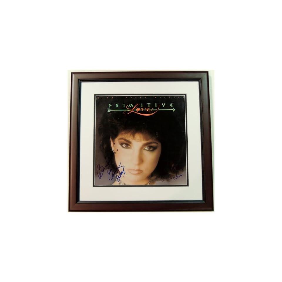 Gloria Estefan and Emilio Estefan Autographed   Hand Signed Miami Sound Machine Primitive Love LP Record Album Cover   MAHOGANY CUSTOM FRAME