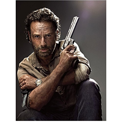 The Walking Dead Rick Grimes with gun in one hand and knife in the other 8 x 10 Inch Photo