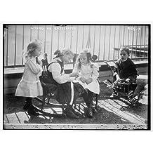 Photo: Children outside on penthouse,New York,NY,little girls,little boy,rocking chair
