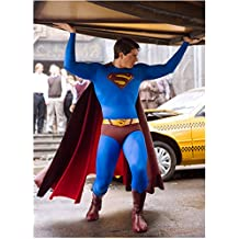 Superman Returns with Brandon Routh Holding The Daily Planet Logo 8 X 10 Inch Photo