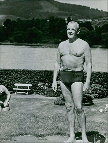 Vintage photo of Sigismund Freiherr von Braun standing and wearing swimming trunks. 1968 ()