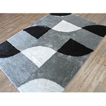 Rug Addiction Alfombra Moderna Color Gris y Negro De UNA Pulgada 100% Poliéster.TAMAÑO: 153 Centímetros Por 214 Centímetros.