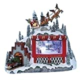 Santa Riding Over Billboard and Train Musical Rotating Christmas Figurine