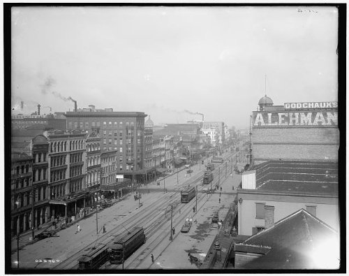 Photo: Canal Street,railroads,commercial facilities,building,New - Street Map Shopping Canal