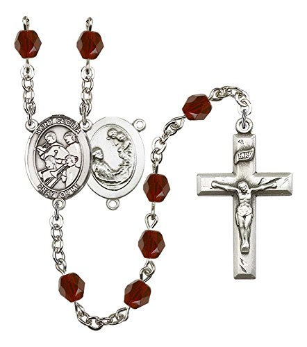 Garnet Rosary Crucifix - Silver Plate Rosary features 6mm Garnet Fire Polished beads. The Crucifix measures 1 3/8 x 3/4. The centerpiece features a St. Cecilia / Marching Band medal.